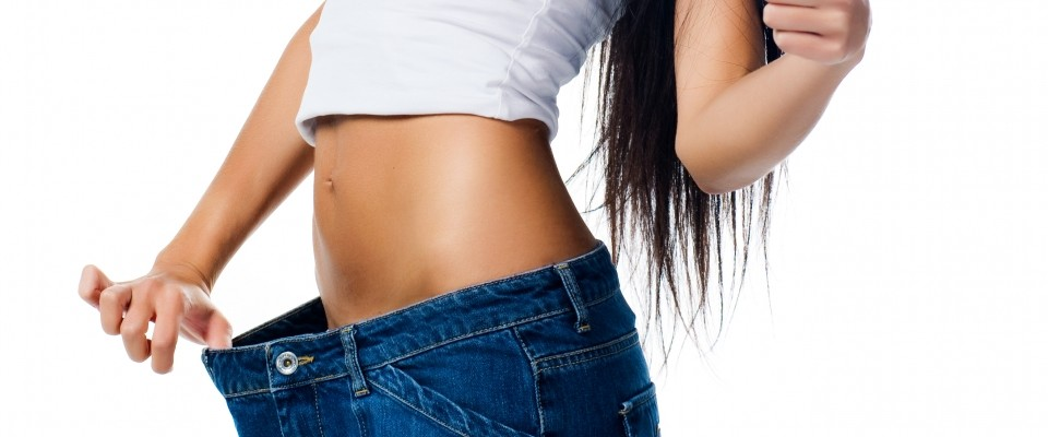 Fit Woman Showing Weight Loss in Old Pants