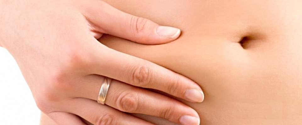 Woman Squeezing Tummy